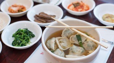 Dduk Man Doo Gook dumpling soup is served