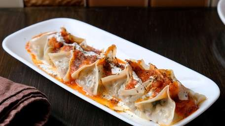 Manto dumplings stuffed with beef and drizzled with