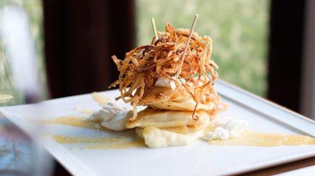 Grandma's Pierogi topped with crispy fried onions, apple