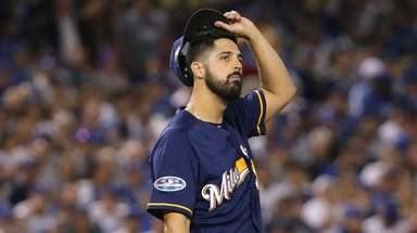 Pitcher Gio Gonzalez reacts during the second inning