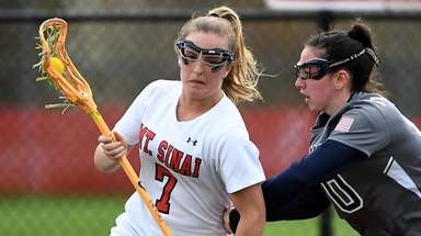 Meaghan Tyrrell of Mt. Sinai is defended by