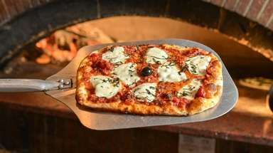 Margherita pizza, made with fresh mozzarella, tomato sauce,