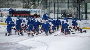 The Islanders gather during practice on Monday, April
