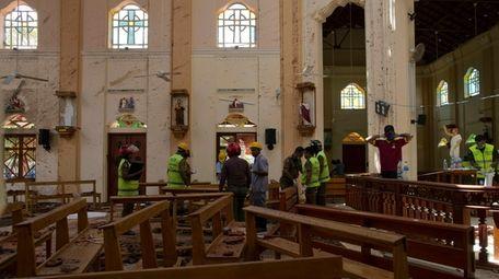 Investigators at the scene of a suicide bombing