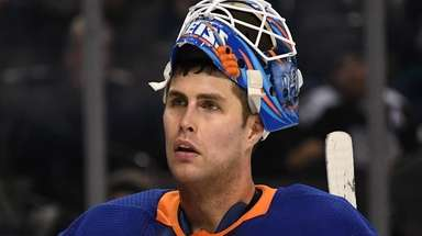 New York Islanders goaltender Thomas Greiss looks on
