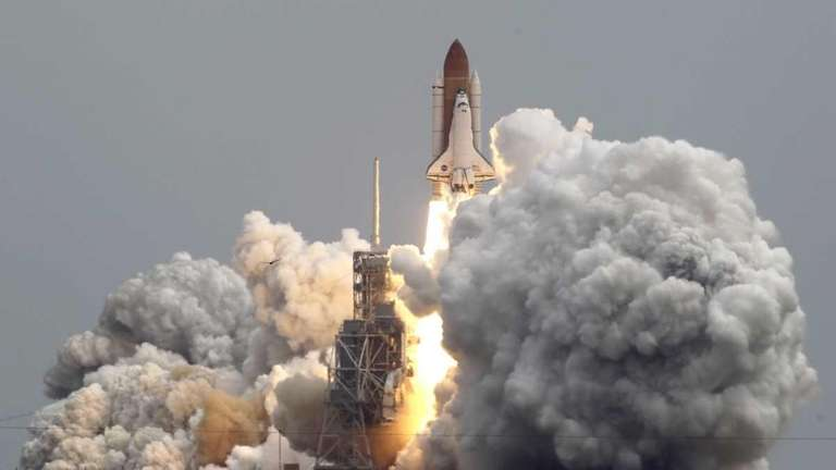 Space shuttle Atlantis lifts off from Pad 39A