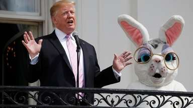 President Donald Trump, joined by the Easter Bunny,