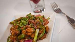 The Hakka chili chicken, boneless pieces of pan-fried