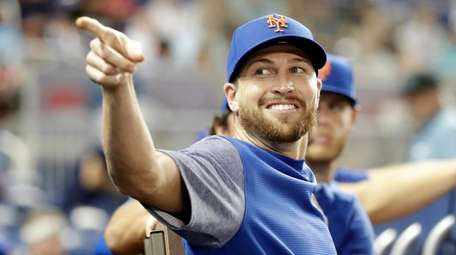 Mets pitcher Jacob deGrom reacts in the dugout