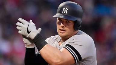 New York Yankees' Luke Voit claps as he