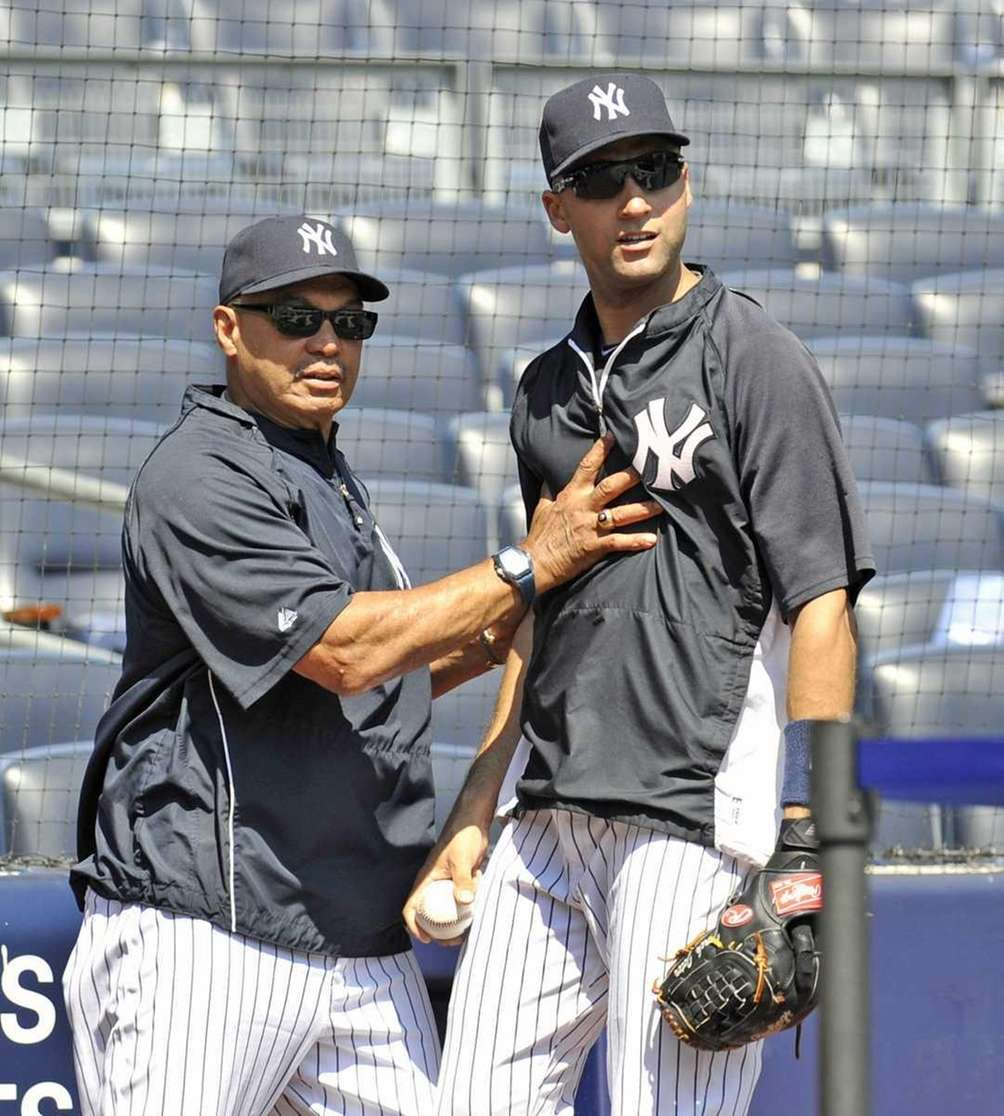 Reggie Jackson gives advice to Derek Jeter before