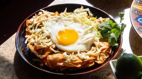 Chilaquiles, fried tortillas topped with a sunny side