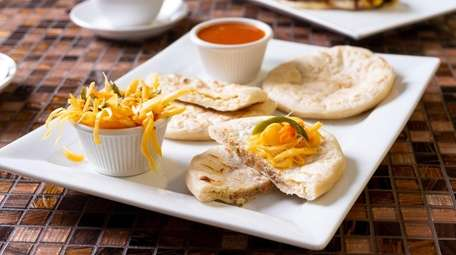 Pupusas, made with pork and cheese, cheese and