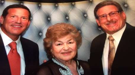 Susan Ettinger, center, with her sons, David, left,