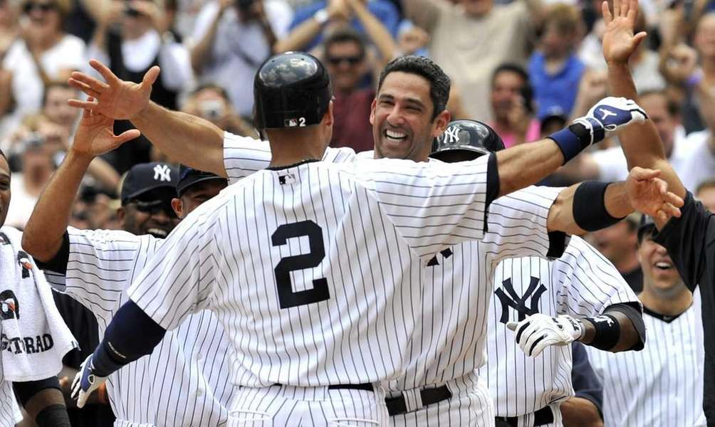 Jorge Posada has a big hug for Derek