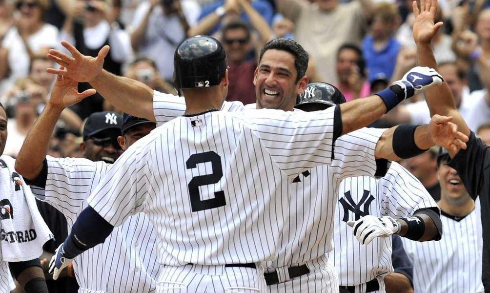 Jorge Posada has a big hug for Derek