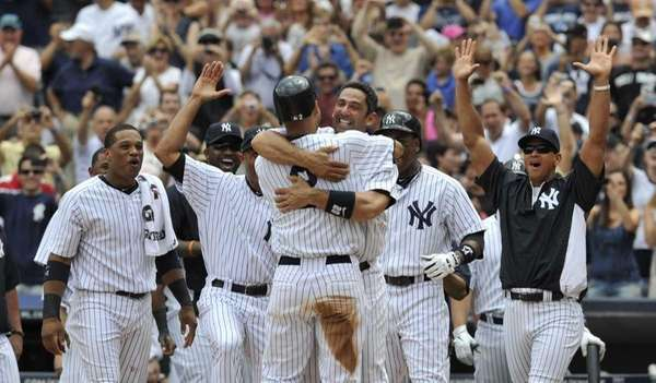 Jorge Posada hugs Derek Jeter after hit No.