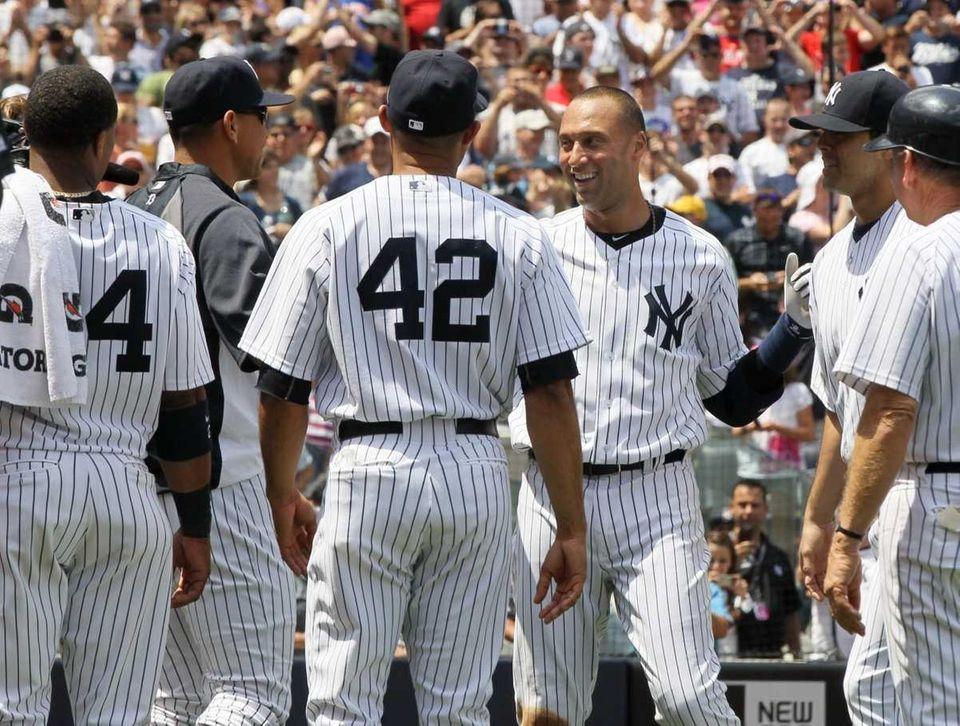 Derek Jeter of the New York Yankees celebrates