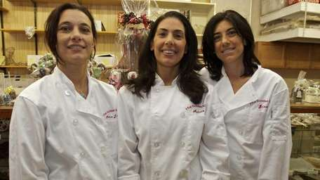 Aurora Hirschfeld, middle, with her sisters Maria Masi,