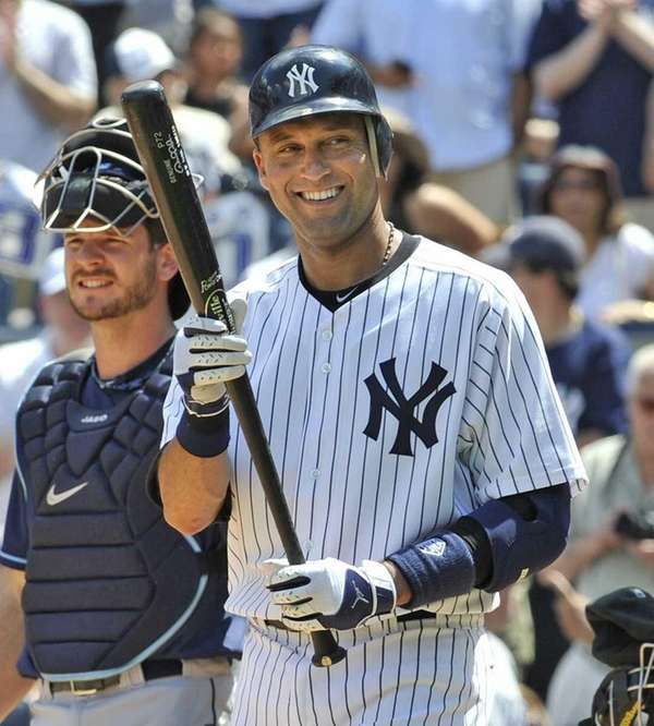Derek Jeter and his bat as he comes