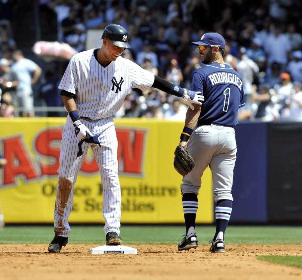 Derek Jeter gives a friendly pat to Rays