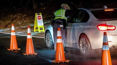 State Police at an earlier sobriety checkpoint in