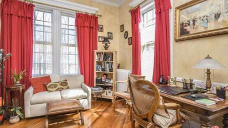 The three-bedroom house has high ceilings and original