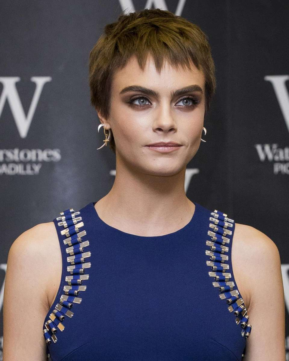 Cara Delevingne attends the signing of her debut