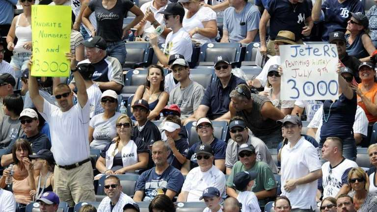 Fans hold up signs before New York Yankees'