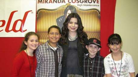Actress/singer Miranda Cosgrove with Kidsday reporters, from left,