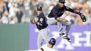 New York Mets shortstop Ruben Tejada leaps over
