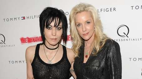 Joan Jett, left, and Cherie Currie attend the