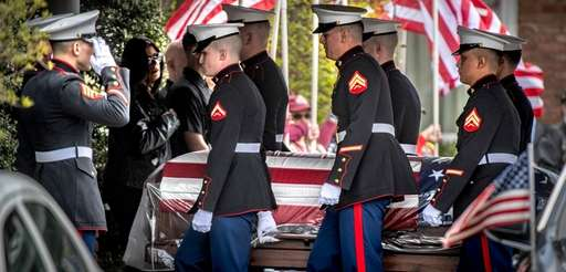 Sgt. Robert Hendriks' coffin is carried into Whitting