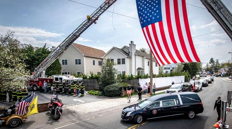 The hearse with Sgt. Robert Hendriks arrives at