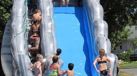 A waterslide at a Wantagh block party.
