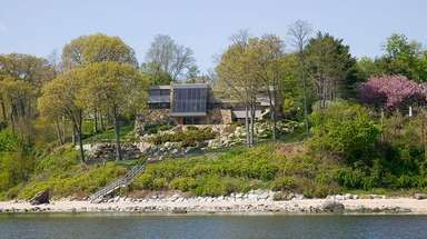 The seven-bedroom Sands Point home, built in 1979,