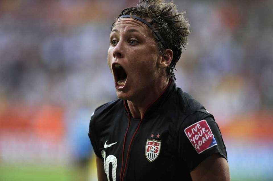 USA's striker Abby Wambach celebrates after scoring the