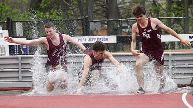 Kings Park and East Hampton runners jump over
