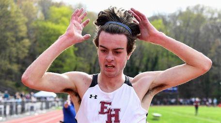 East Hampton's Ryan Fowkes raises his arms after