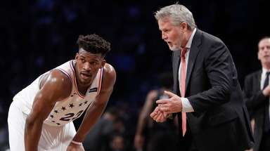 Philadelphia 76ers coach Brett Brown, right, talks to