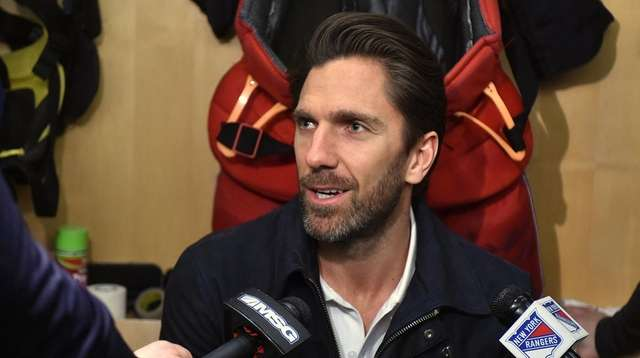 Henrik Lundqvist of the Rangers speaks with the
