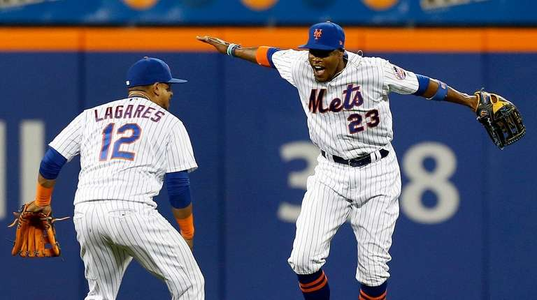 Keon Broxton and Juan Lagares of the Mets