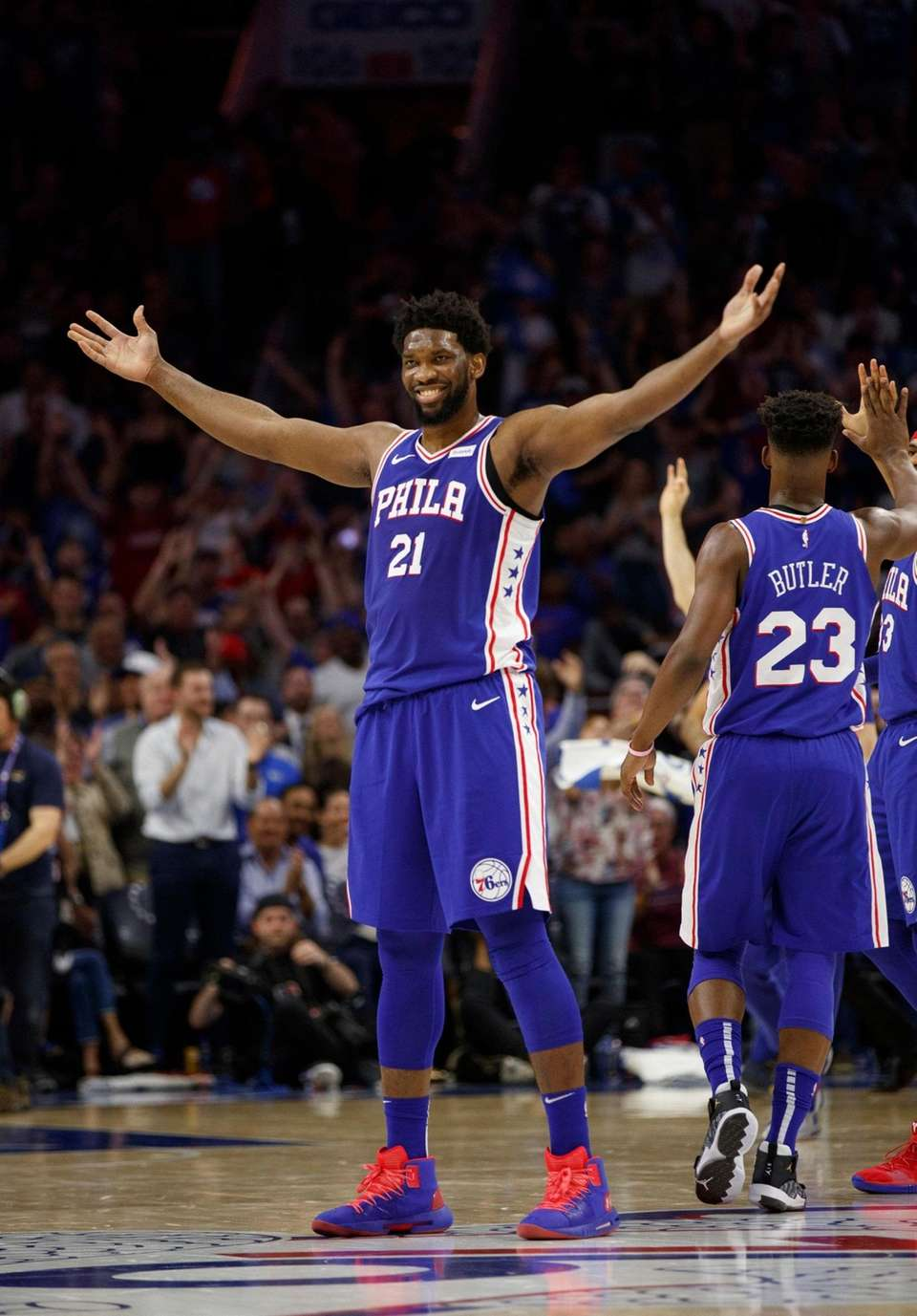 The 76ers' Joel Embiid reacts to his basket