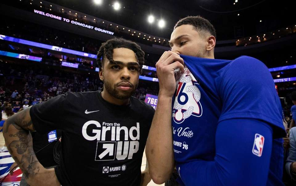 The 76ers' Ben Simmons, right, talks with the