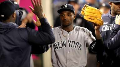 Domingo German of the Yankees is congratulated in