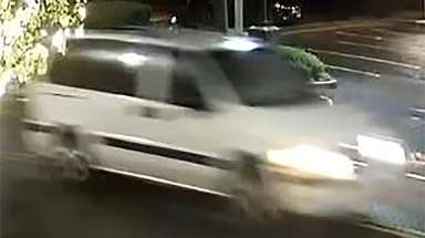 This surveillance image shows the minivan sought in