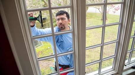 Ricardo Lopez of Crystal Clear Window Cleaning working