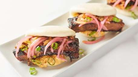Pork belly buns (bao) with kimchi slaw, pickled