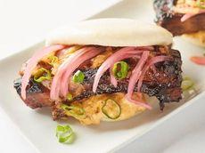 Pork belly buns (bao) with kimchi slaw, pickled