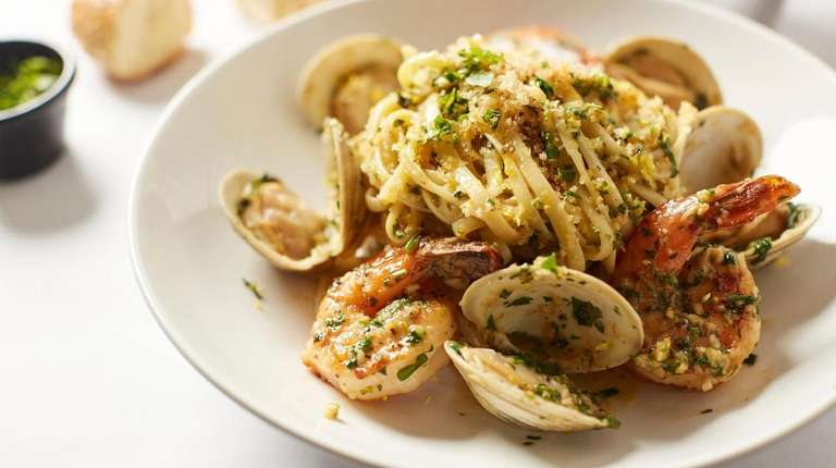 Linguini with clams and shrimp, tossed in white